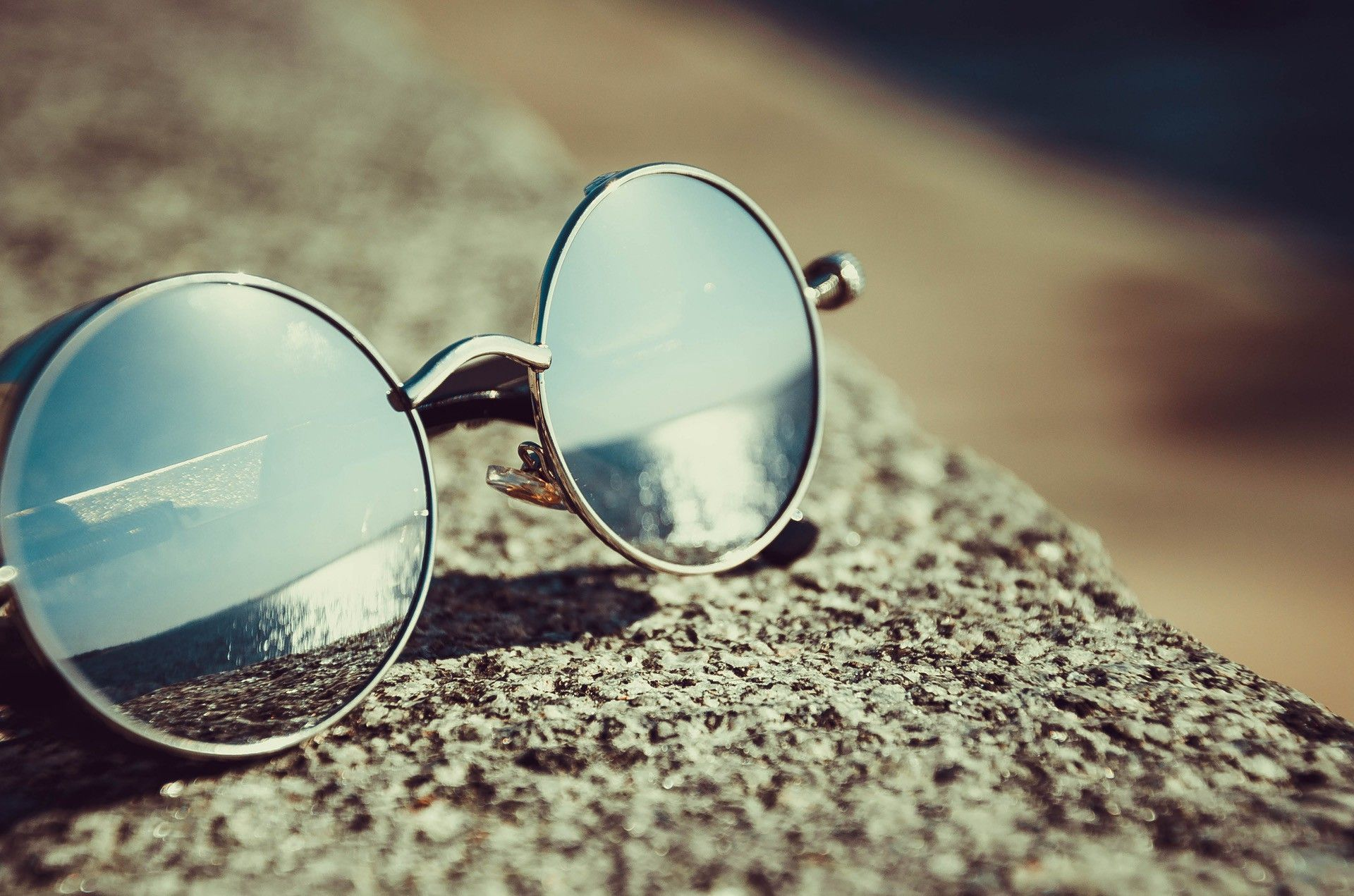 Sunglasses make people look more attractive because they give the illusion of a chiseled bone structure on top of a soft-featured face.