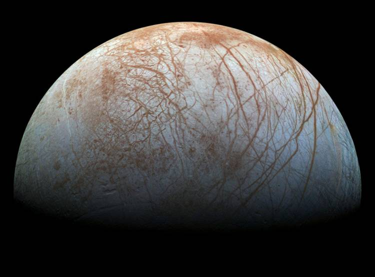Not all moons are dry and dusty like ours. Jupiter's Europa has a liquid ocean under an icy crust.