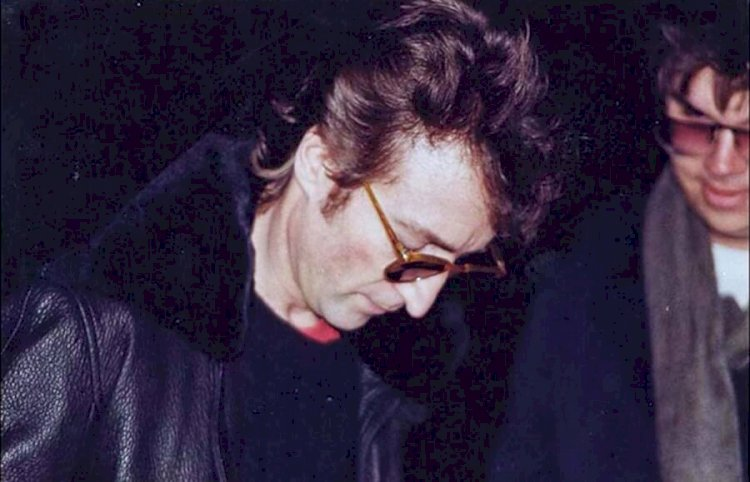 The last picture taken of John Lennon while he was alive had his killer in the frame.